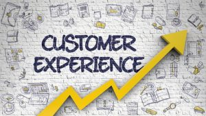 wall with grffity 'customer experience'