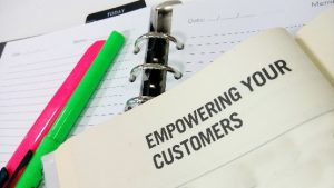 Notebook with title 'empowering your customers'