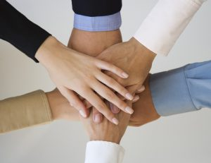 Group of hands together on top of each other