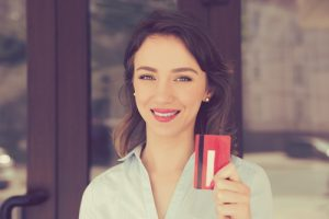 Smiling with a credit card