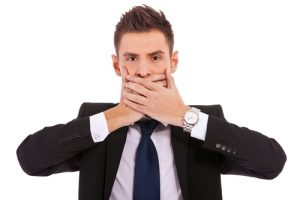 businessman holding his mouth with his hands