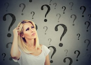 woman with surrounding question marks